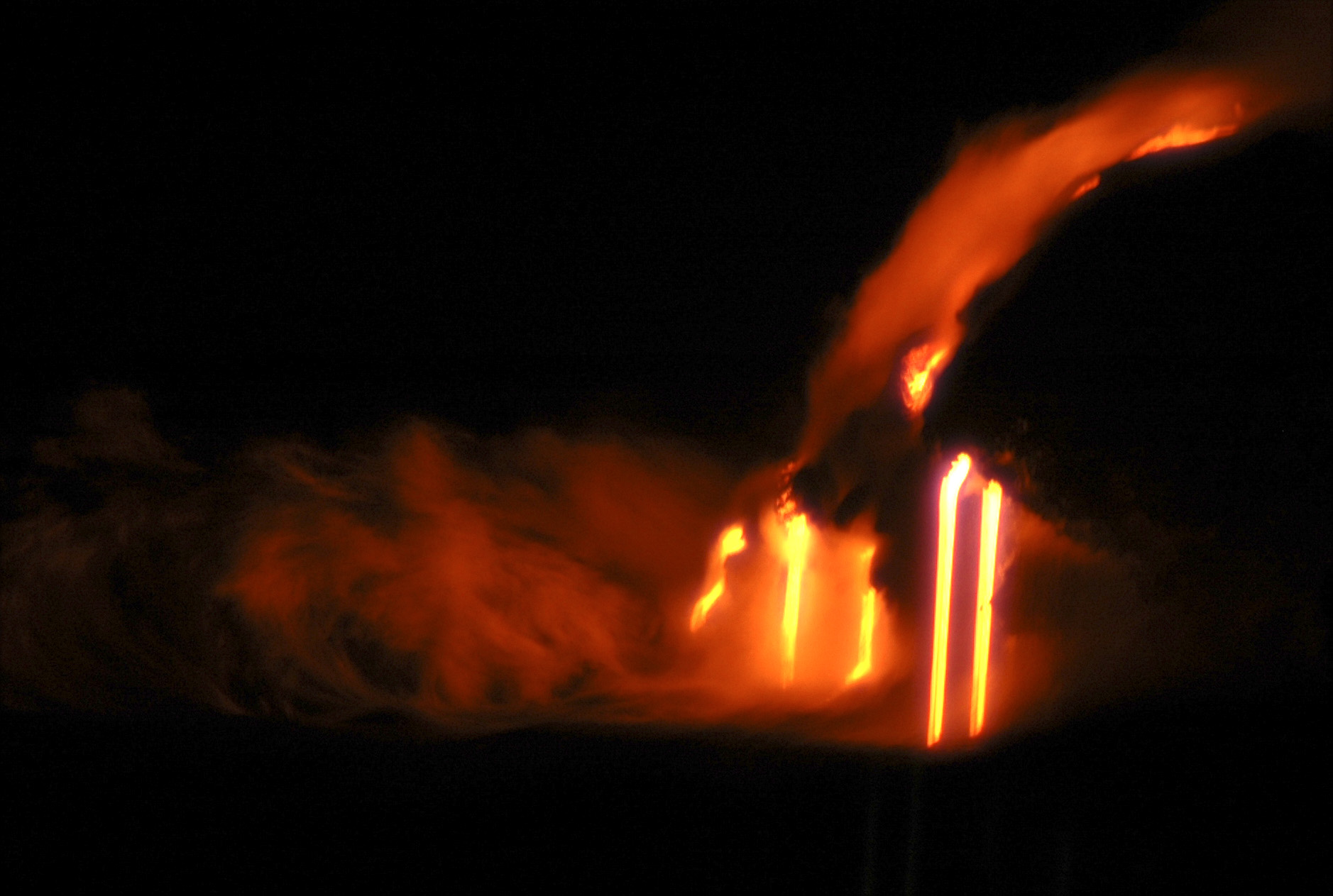 Lava flowing into crashing waves