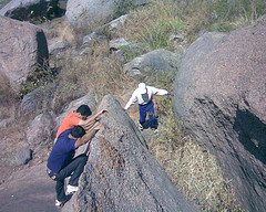 Climbing a small knife-edged boulder