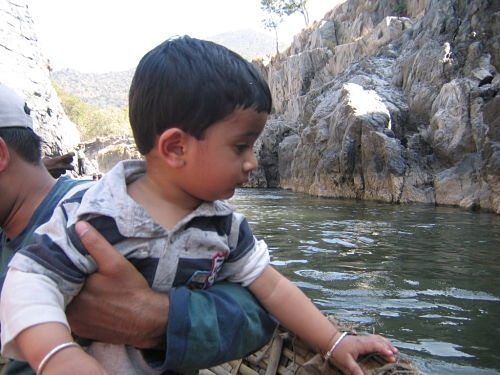 my son playing with river water