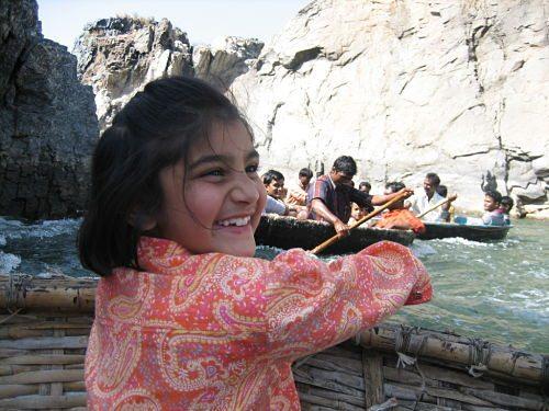 Kids having fun in boat- enjoying water