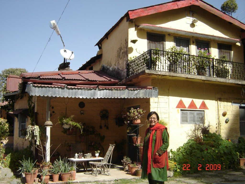 Mrs Rawat with some of the plants Outside their house