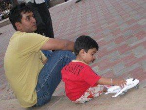 father - son relaxing outisde Madurai Temple