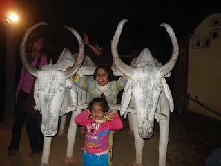 Swarika holding her ear instead of cow