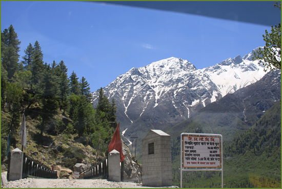 chitkul-a-small-bridge-overlooking-huge-mountains