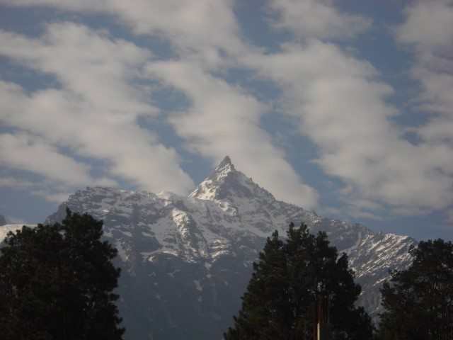 Kinner Kailash adorned by beautiful clouds