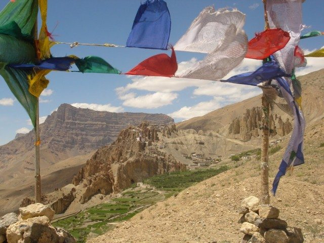 Dhankar Monastery seen through fluttering prayer flags