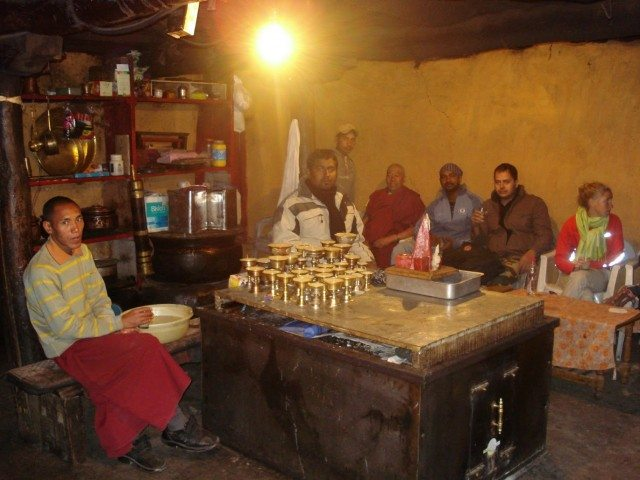 Having butter tea inside the Kye Monastery Kitchen