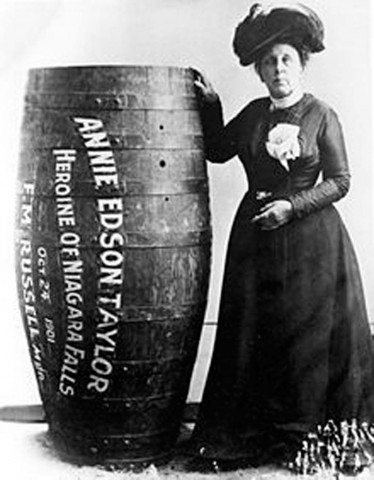 Annie Taylor posing next to her barrel