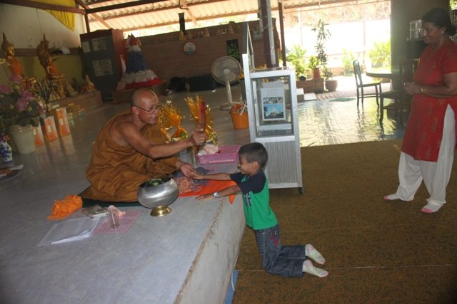 Blessings and tying of the sacred thread by the monk.