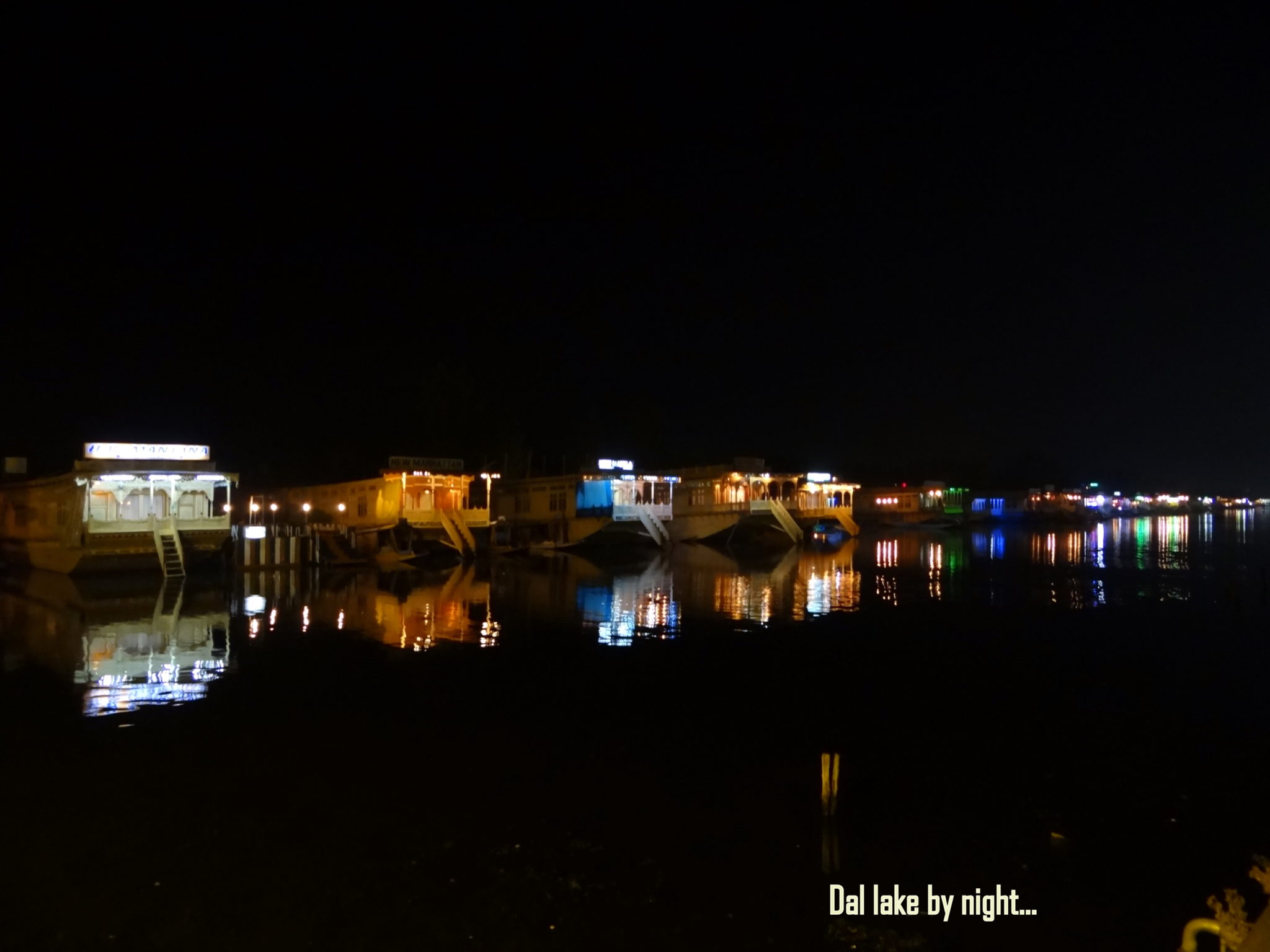 The Houseboats on the lake, at night