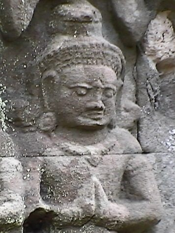 A bas-relief over an entrance at Ta Prohm includes this intense meditating or praying figure - Courtesy Wikipedia