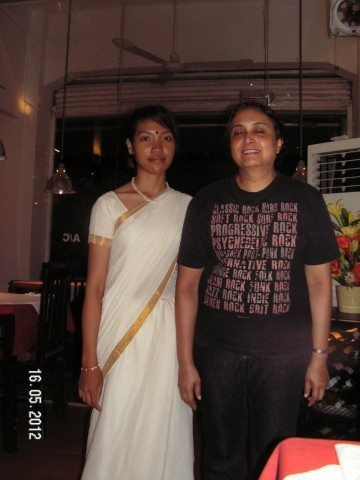 A Cambodian waitress and me at 'The Indian' restaurant in Siem Reap