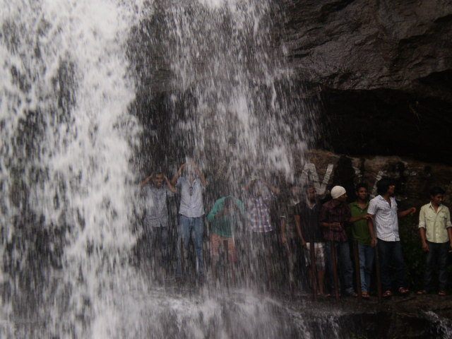 Tourists enjoying waterfalls