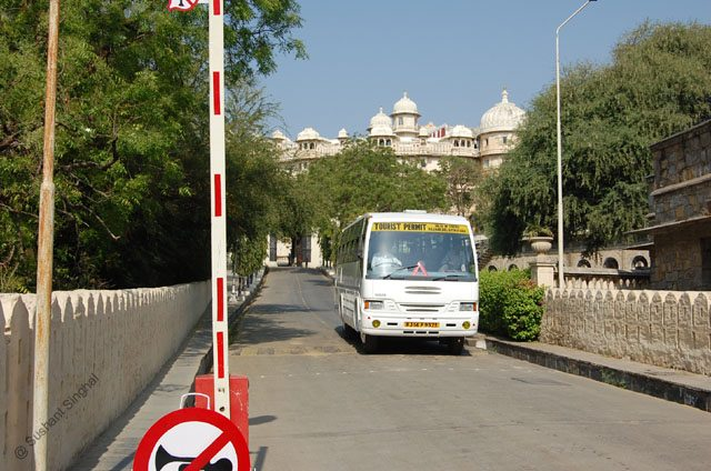 A tourist bus on its way back to the city from City Palace.