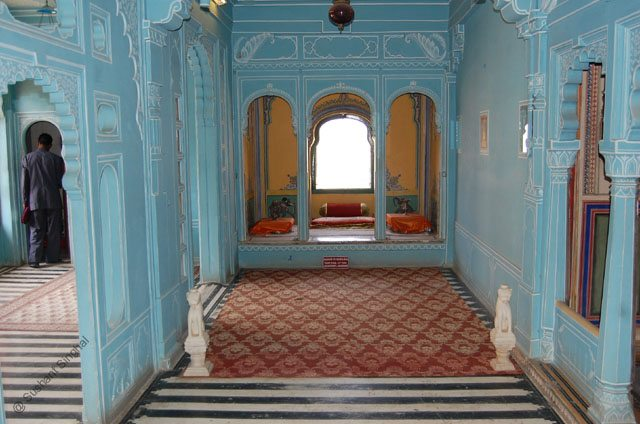 Let's sit in this balcony inside City Palace.