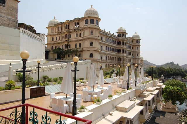 Sunset Terrace Restaurant against backdrop of Fateh Prakash Palace HRH Hotel, Udaipur