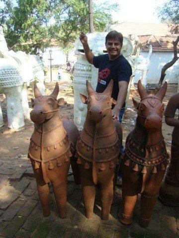Posing near Terracotta Animals