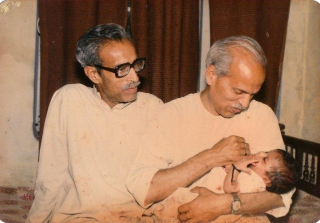 My father and Chachaji with Akshat in Chachaji's hands