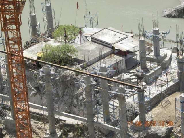 Raising the Dhari devi temple  on pillars  to prevent it from sinking because of the construction of the Dam.
