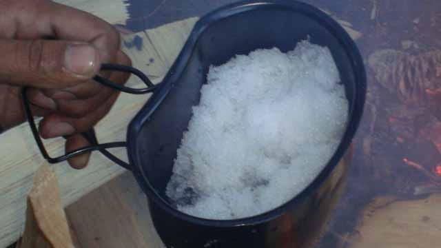 Paahji melting some snow Bear Grylls style