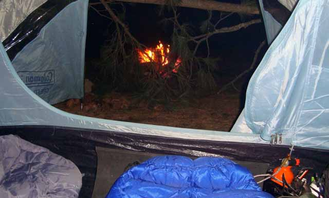 – View of the campfire from inside the tent