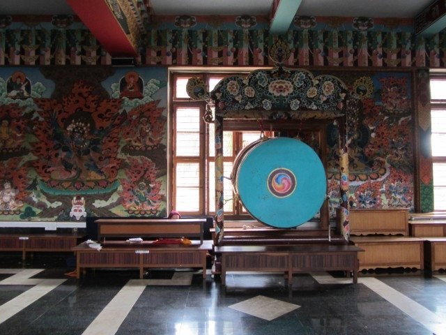 A Tibetan Drum along with the beautiful paintings adorning the walls