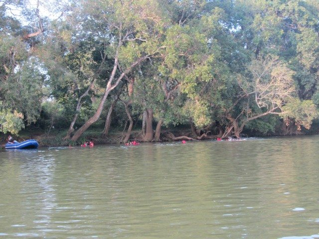 Tourists taking a dip in the Cauvery in their rafting gear
