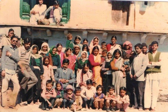 At my village (me on the last row in green with my mother)