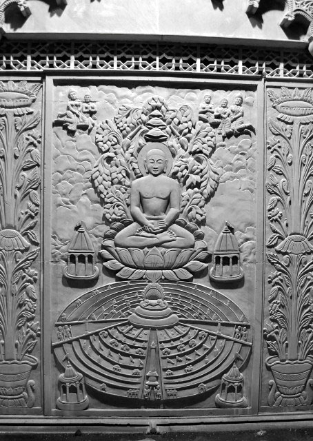 Intricate engravings depicting Jain Tirthankar.