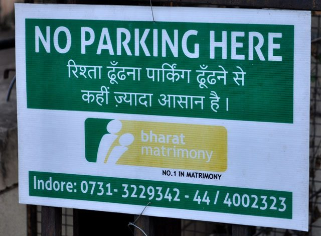 Interesting sign boards in front of some bungalow.