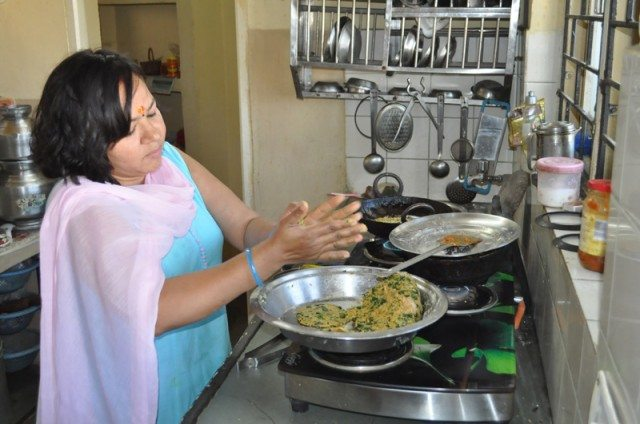 Kavita in her kitchen - preparing breakfast for all of us.