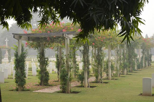 Neat, green, flower filled cemetery