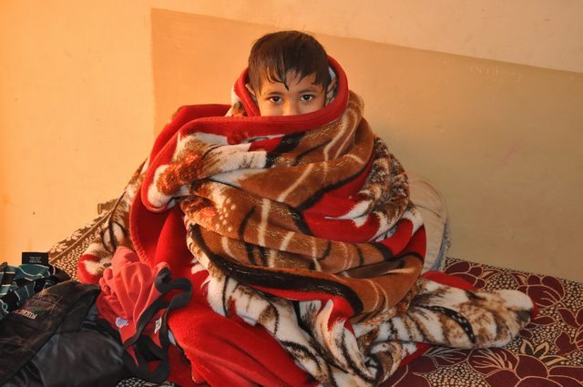 Shivam, wrapped in blanket in cold morning.