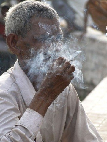 Stolen picture... an old villager busy with his smoking !