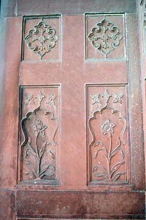 Floral designs on its red stone walls