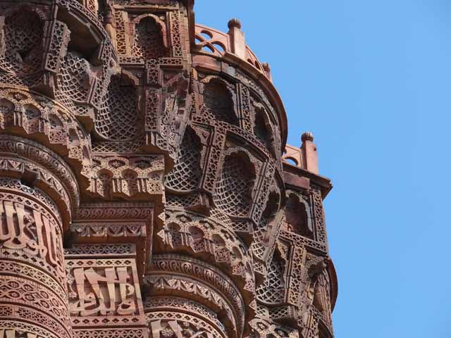 Qutb Minar - Exquisite Muqarnas Corbel Details under the Projecting Balconies