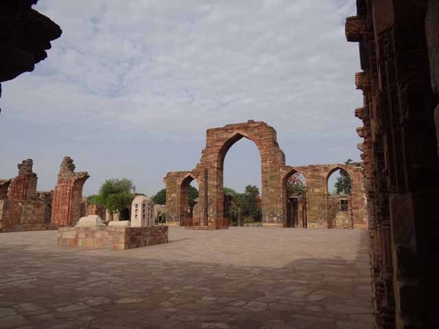 Quwwat-al-Islam - Mosque Courtyard with Arch Screen and Iron Pillar