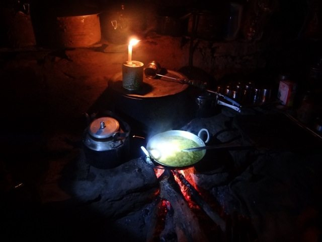 Cooking dinner by candlelight