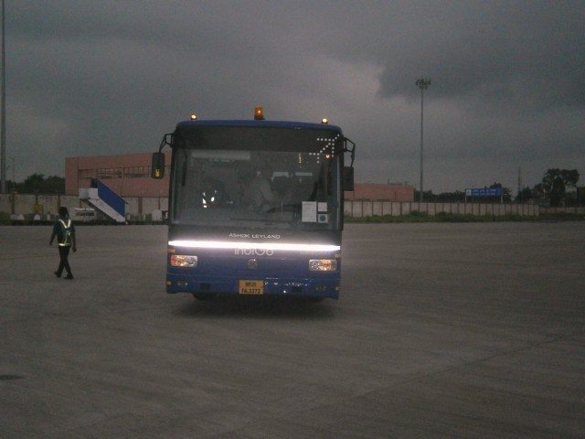Indigo Bus carrying passengers from lounge to plane
