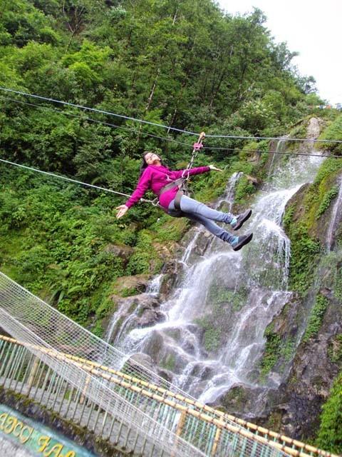 Enjoying rope slider at Bakthang Waterfalls