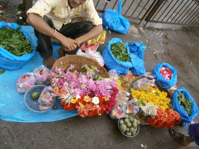 A flower seller near temple...