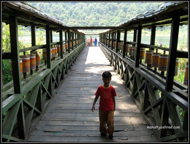 Wood bridge lined with prayer wheels @ Khecheopalri
