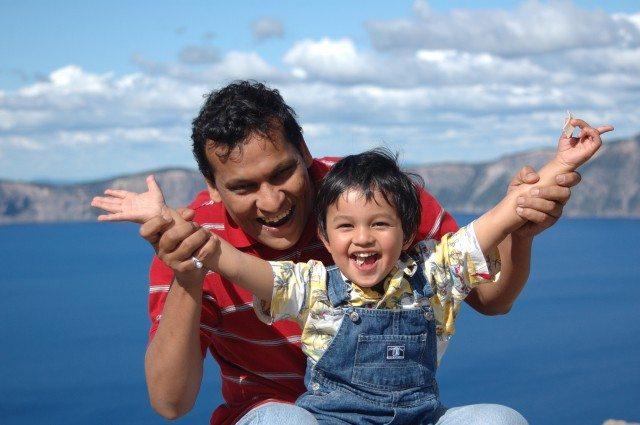 Upanshu with his son at Crater Lake