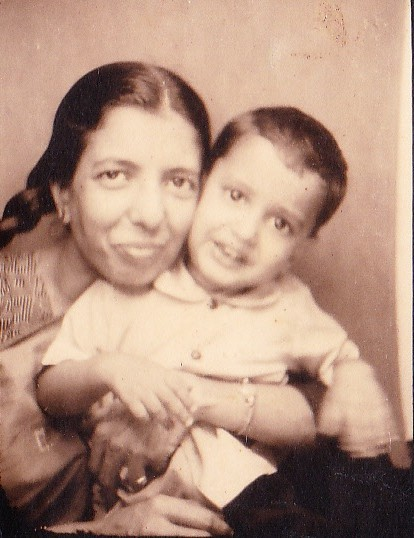 Taher with his mother - this is the only picture he has of his real mother - from his father's collection