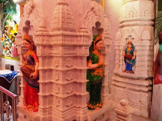 Beautiful statues on Marble Pillars