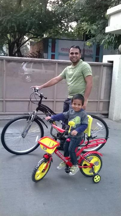 Cycling with his son