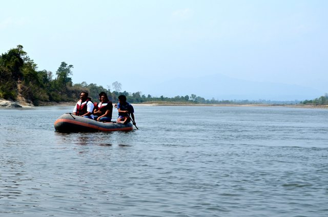 A team leisurely rafting in the Jia Bhoroli River