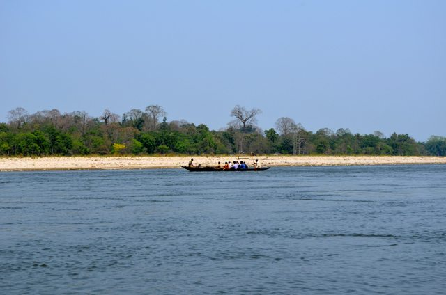 Visitors crossing the Jia Bhoroli River