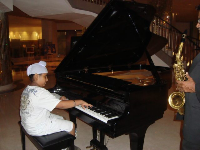 Ravi demonstrating his piano skill at Lebua in Delhi