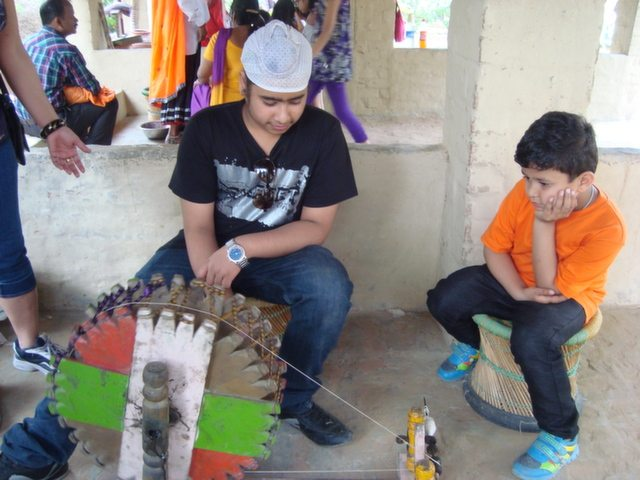This charkha is made up of Sandal wood or not, I do not know, but Ravi is operating it with the same preet!!!